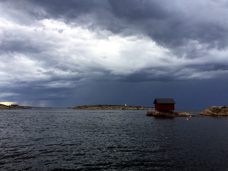Dramatic skies, with a thunderstorm brewing in the north.